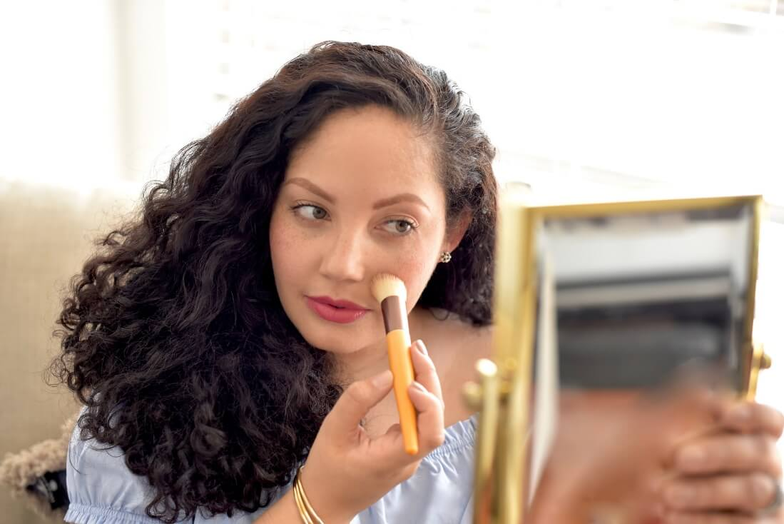 Demonstrating how to apply BB cream with a brush