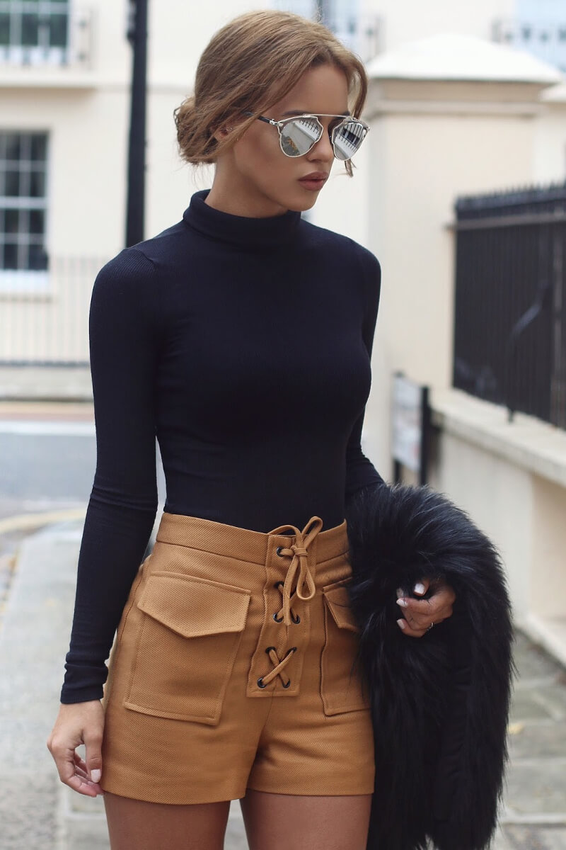 "The velvet short by themselves are significant fashion piece, but in combination with lace up detail on the top they are going up on the list ""Things I need to have"". An elegant blondie with big mirror sunglasses, turtle neck top and brown velvet shorts with ties instead of zipping."