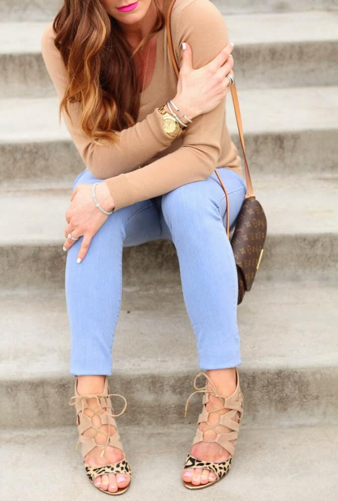 Casual outfit made of a beige sweater and blue jeans with an accent on the amazing leopard lace up sandals. The lace ups in footwear can go in combination with almost anything. Even an amazing leopard pattern that every fashion icon loves looks more than great with laces.