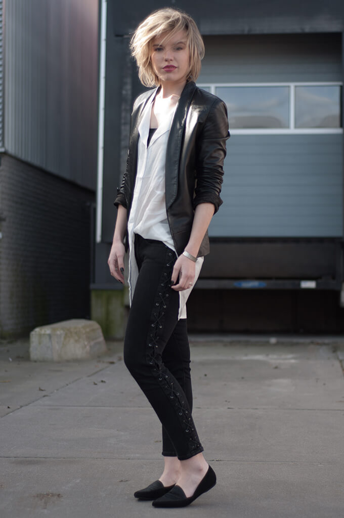 Autumn outfit made of a leather jacket, long white shirt and black jeans with lace-up sides. The lace up side detail along your legs will visually lengthen them, and it is never superfluous.
