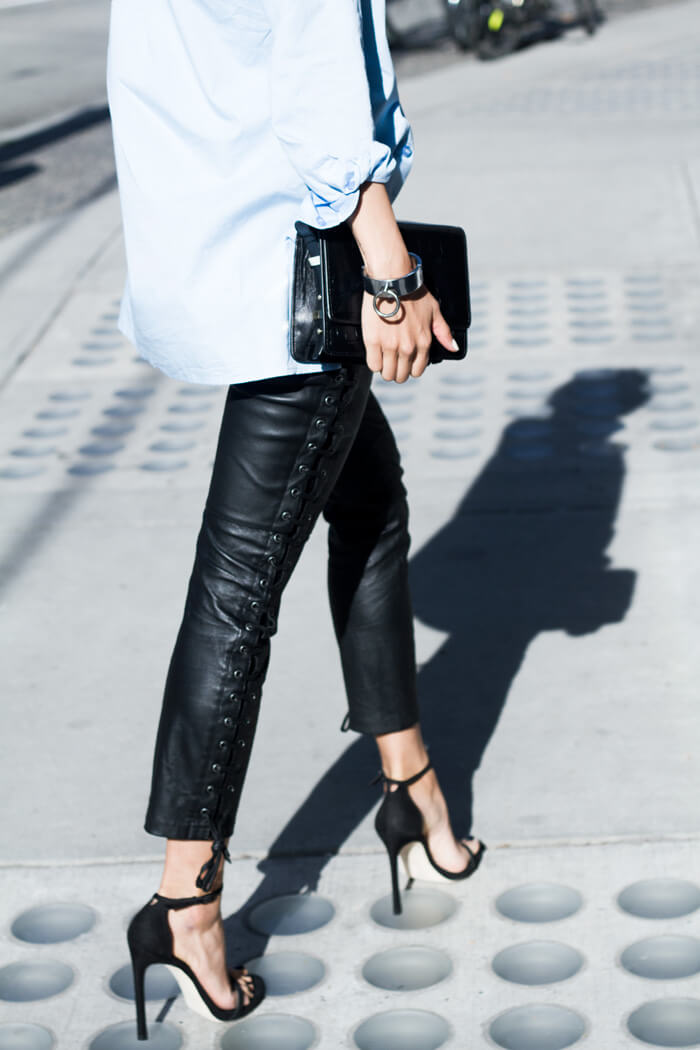 Oversized shirt combined with sexy leather pants with lace up sides and ultra-high heel sandals. Be a hot Rock 'n' Roll queen with leather trousers matched with an oversized shirt or blazer. A pair of heels is a perfect finish to this glamorous outfit.