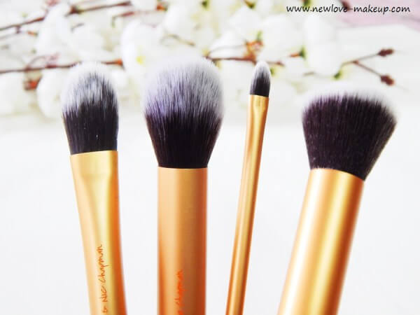 RealTechniques brushes come with gold handles and black and white bristles. The set includes four brushes: foundation, contour, detail, and buffing.