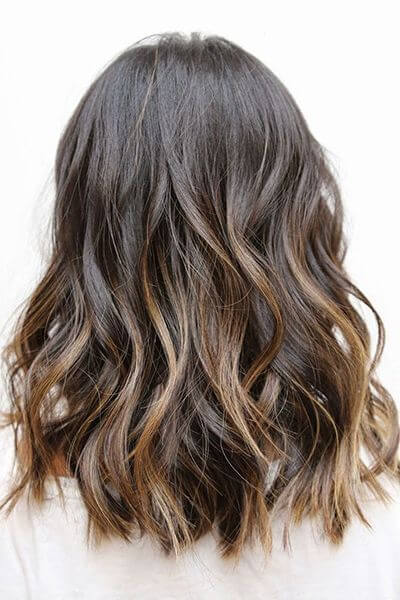 Brown hair with golden caramel highlights