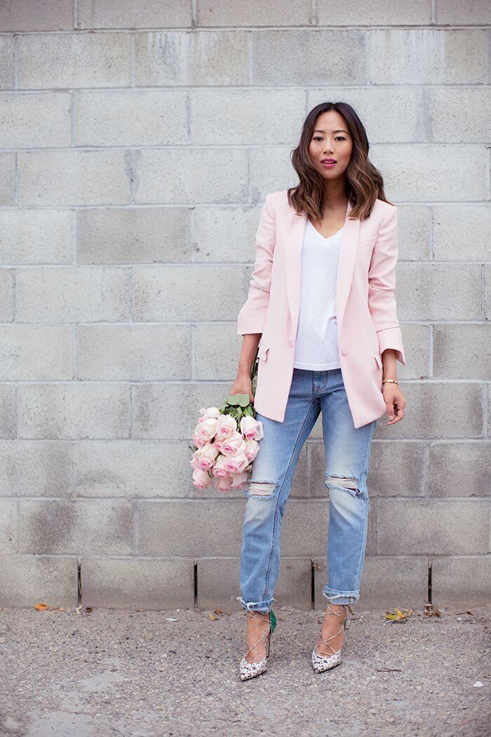 Aimee Song is showing how to wear a pink blazer, white tee, ripped boyfriend jeans and laced up heels