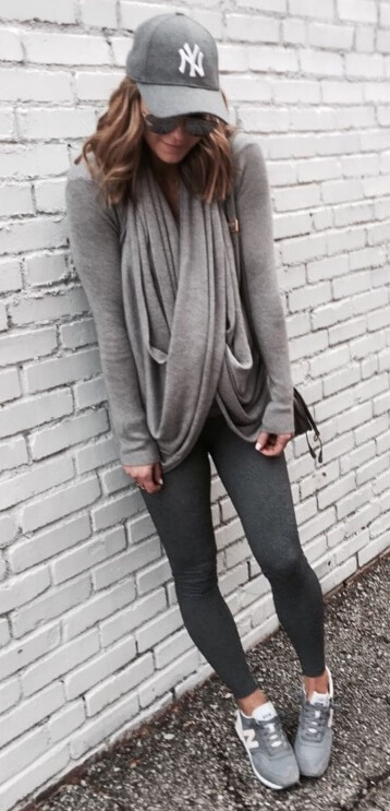 The athleisure trend was designed especially for easygoing fall days. Look your comfortable best in charcoal leggings, a fitted gray sweater plus a draped gray scarf in the same color. To up the sporty effect, be sure to throw on trendy New Balance sneakers and your favorite baseball cap.