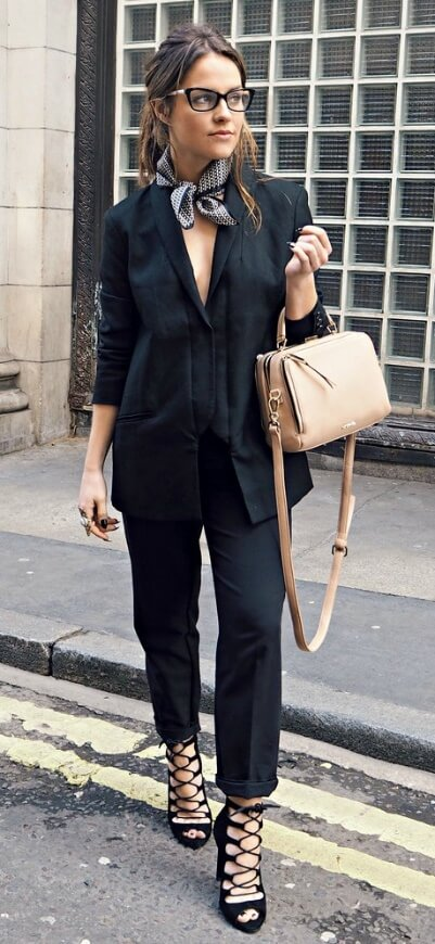 Here's a trick that French women know – all black from top to toe equals instant elegance. Add a gray handkerchief scarf to your neck and capture that European glamour.