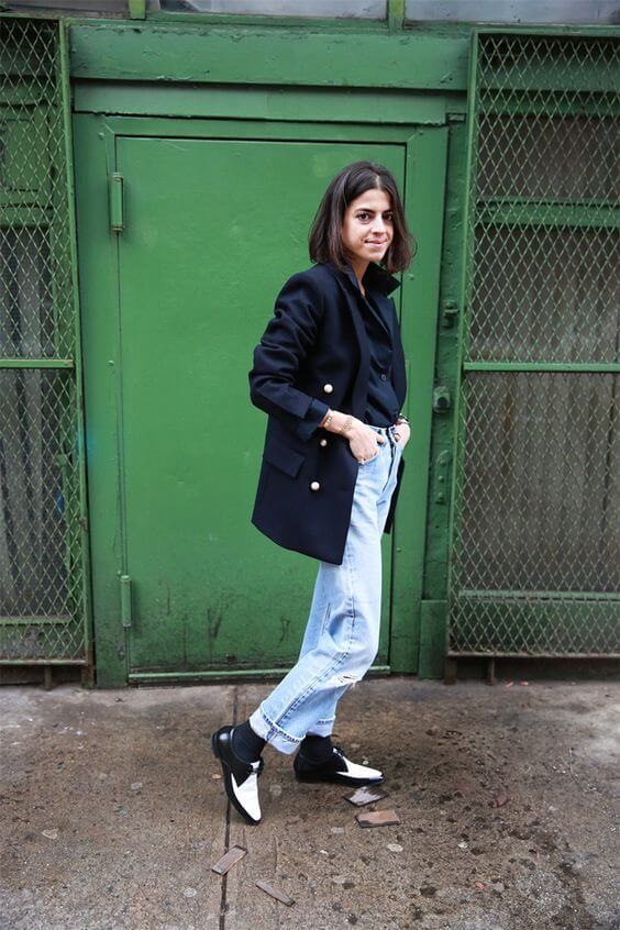Leandra Medine wearing Céline double breasted jacket, black blouse, vintage Levi's jeans, black & white brogues and gold bracelets