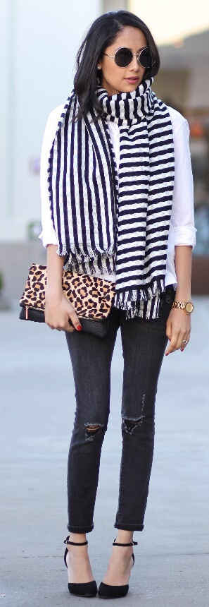 One of the biggest and most enduring trends from the past few months is undoubtedly stripes. Pair a two-toned scarf with a classic white blouse and black ripped skinny jeans for a timeless yet still trendy look.
