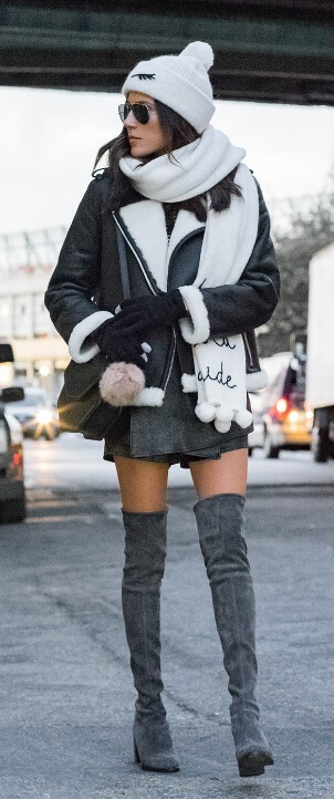 Neutral does not have to mean boring and here's the proof. Show a tiny sliver of skin and wrap the rest of your body in layers of charcoal, black and white. The finishing touch? A matching set of a woolen scarf and beanie.