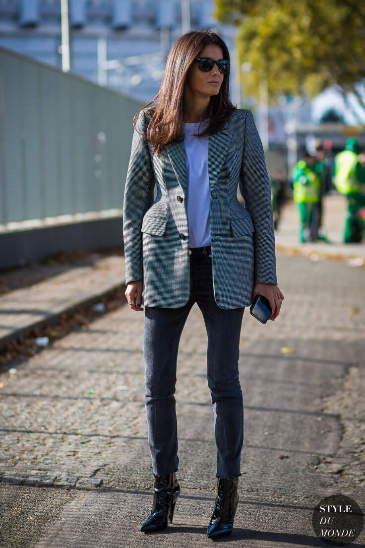 Hourglass blazer frames women's elegance. Here a blazer is worn basic white t-shirt, deep gray jeans and patent-leather ankle boots