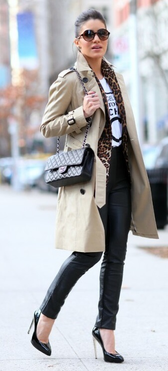 A logo T-shirt plus a beige trench coat sums up chic fall style. Add a thin patterned scarf for an extra dose of pizzazz.