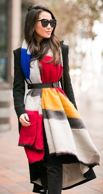 Keen to make a color splash this season? Look for solid blocks of bold color in red, mustard and black like in this long, belted scarf.