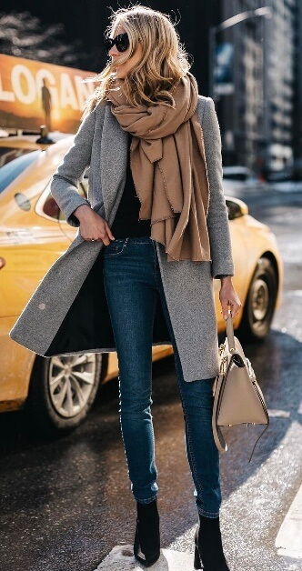 This look is all about sleek, elegant lines which slim and lengthen the frame. Then comes a chunky, oversized scarf to add bulk and comfort on top – simply sublime!