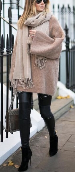 Fringed edges are all the rage right now. Get in on the trend and drape your neck in a fringe-hemmed scarf to complement an outfit of leather and wool.