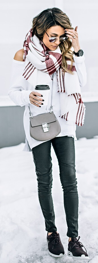 Here's proof that accessories do make the outfit. A roomy white and burgundy plaid scarf turns this day outfit into an athleisure style triumph.