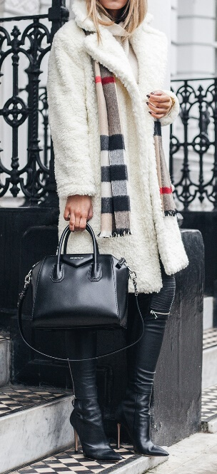 A winter white shearling coat meets black leather pants – here's a combination made for fearless, edgy women with an eye for fashion. For an unexpected twist, drape a Burberry plaid scarf around your neck for a classic, old English effect.