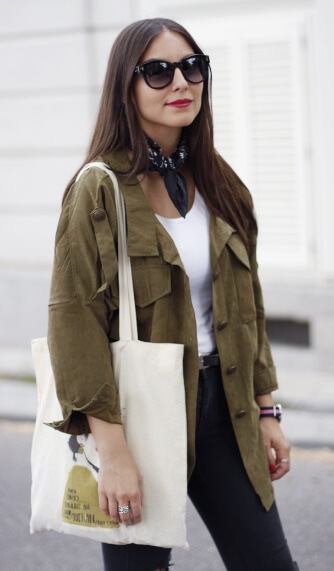 Pair that must-have military jacket with black denim jeans and a simple white T-shirt. Then, for a more polished appearance, you can't go wrong with black sunglasses and a little scarf tied at the neck.