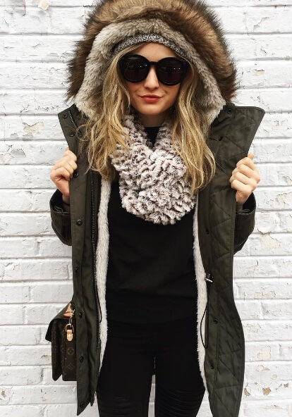 Faux fur never goes out of style, especially in chilly fall temperatures. Cover up Russian style with a fur-lined khaki parka and accessorize with an oversized black and white scarf for stellar style points.