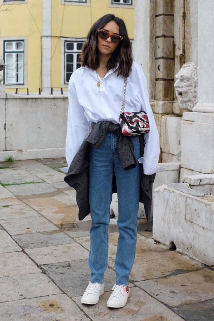 An excellent example of unusual way to wear blazer — to wrap it around your white shirt & boyfriend jeans and finish it with white converse.