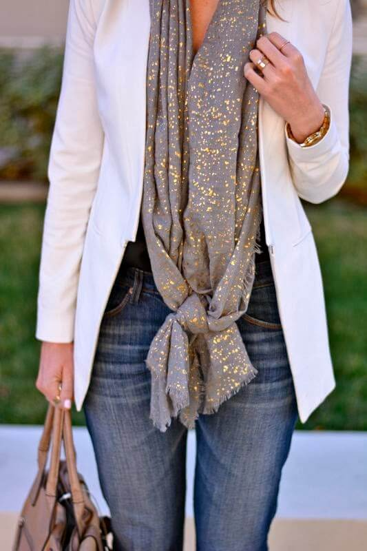 There's always time for a bit of sparkle and fall fashion is no different. Take your spring gold-speckled scarf and knot it casually at the ends – chic and sophisticated in an instant.
