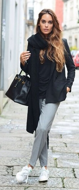 This look exemplifies modern French city style. Get that je ne sais quoi with the combination of simple gray tailored pants, a black sweater, and a black blazer. Top it all off with a long black scarf and trendy Adidas Stan Smith sneakers.