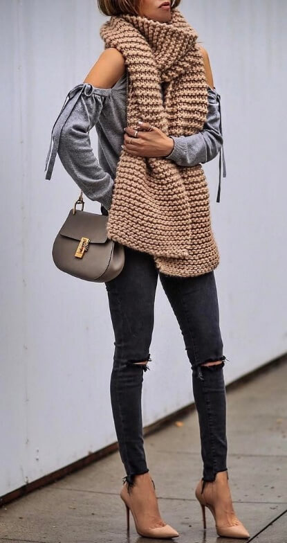 Take all of those urban style essentials and combine them into one edgy fall ensemble. What makes the outfit unique, though, is an oversized garter stitch scarf perfect for chilly fall temperatures.