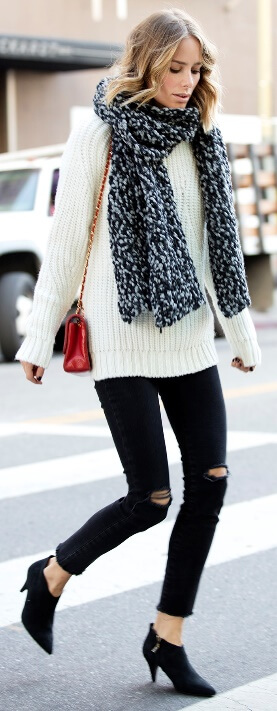 A chunky woolen scarf and a plush lamb's wool sweater are all you need to warm up on a dreary fall day.