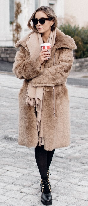 Cool fall temperatures mean you can finally take that luscious fur coat out of storage. This standout piece is an outfit in itself. All you need to go along with it are black leggings, Doc Martin boots, and a fringed beige scarf.