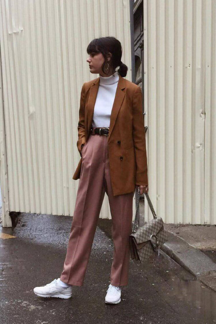 The perfect palette for a rainy day. Her style nouns with double breasted camel blazer, white turtleneck, dirty-pink wide-leg pants, white Asics and Gucci bag.