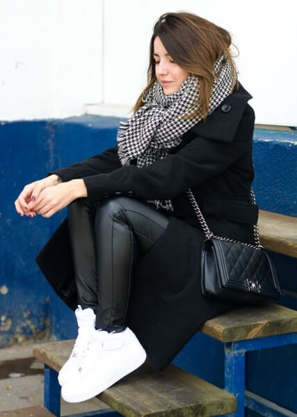 Everyone looks good in an outfit of pure black, especially with an unexpected pop of color in white sneakers. Accentuate the monochrome effect with a luxurious yet simple houndstooth scarf.