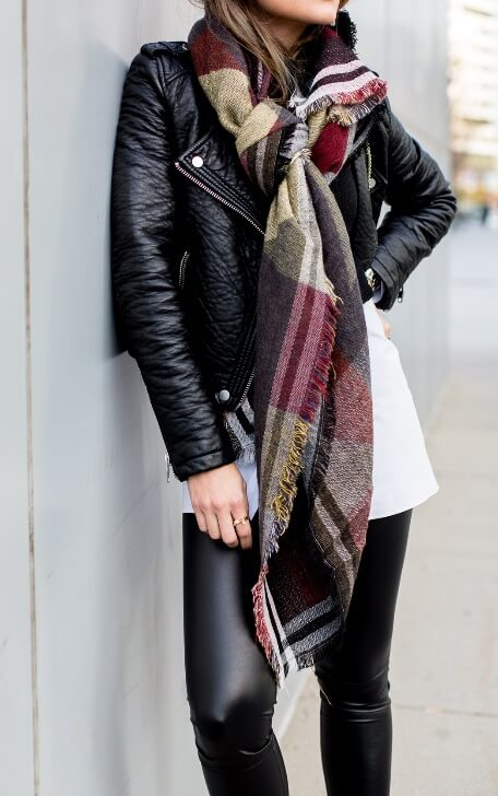 Fall weather brings the welcome return of edgy black leather. Add some color and dimension to the urban look with a long-printed plaid scarf.