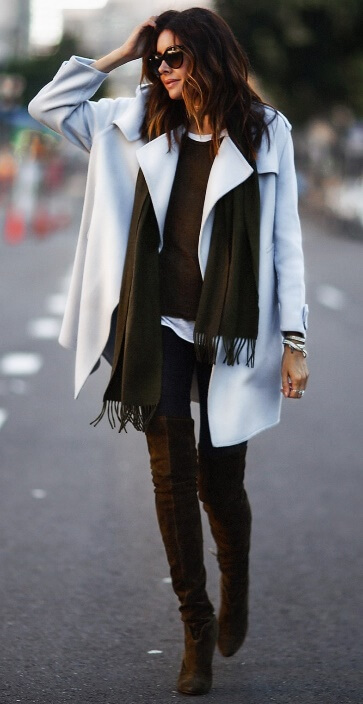 Take the guesswork out of dressing for unpredictable fall weather. How? With layers of fabrics. Take black leggings, a white T-shirt plus an olive green fringed scarf for layers of warmth and style.