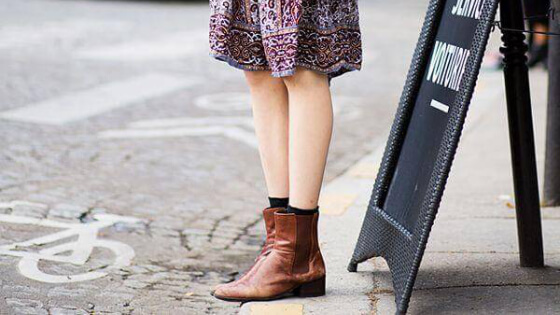 Give your summery boho dress a fall makeover by pairing it with comfy brown booties