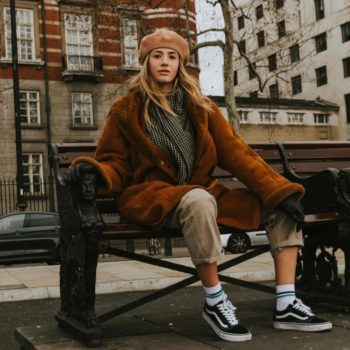 Learn how to create your own style: a stylish woman on a bench