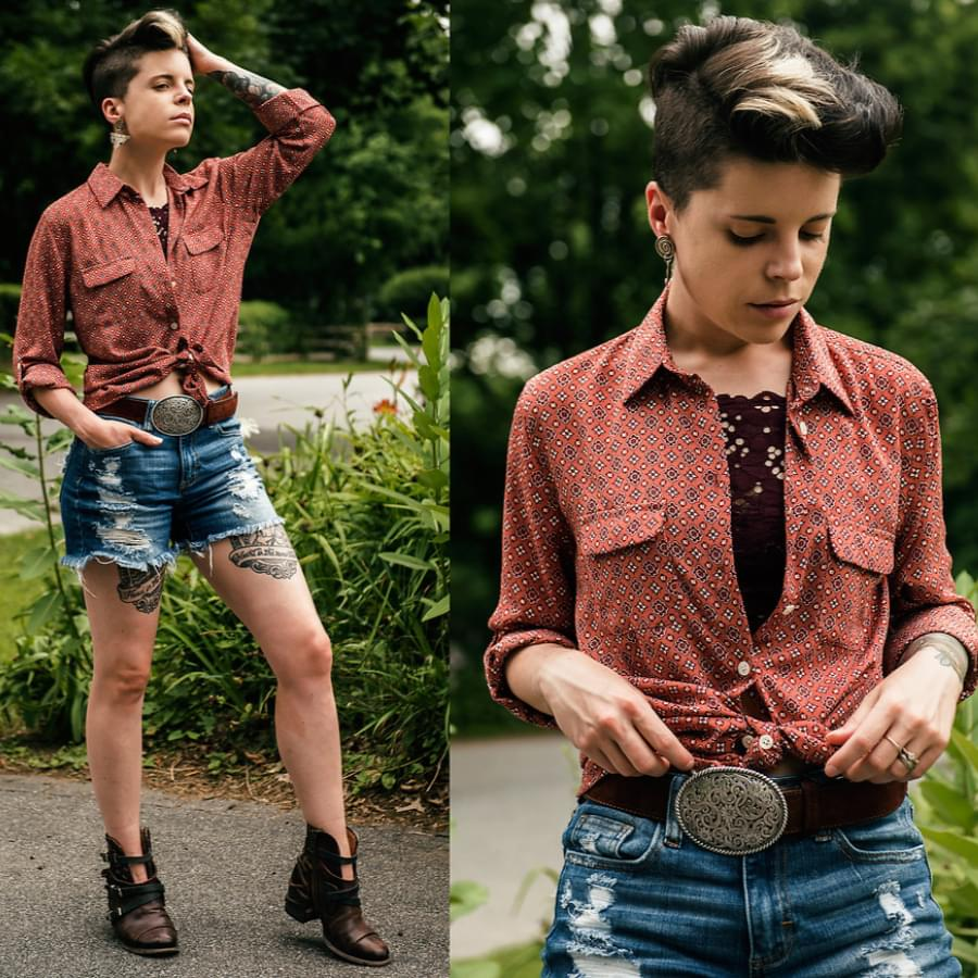 Girl wearing a shirt. Learn how to shrink a shirt to a perfect fit.